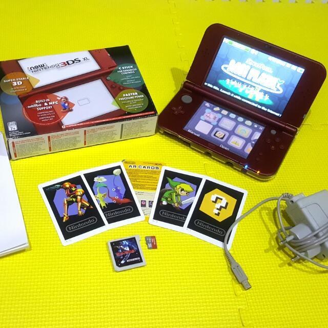 New NINTENDO 3DS XL w/ Sky3ds+ (Orange Button)