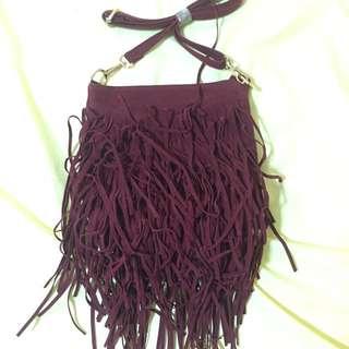 Maroon fringe sling bag