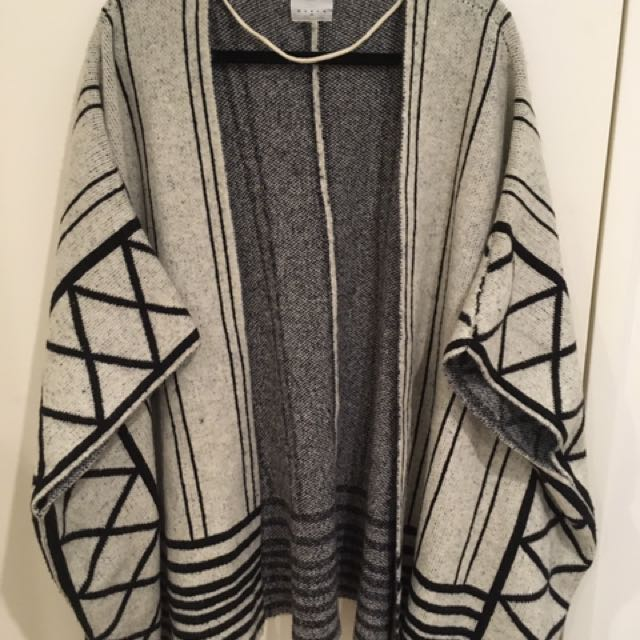 Knitted Cream And Black Poncho