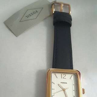 Fossil ladies watch, rose gold facia with a navy blue wrist band