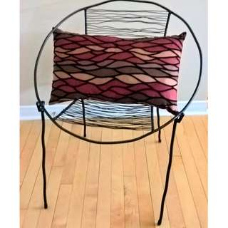 Iron accent chair with pillow. Incredible piece.