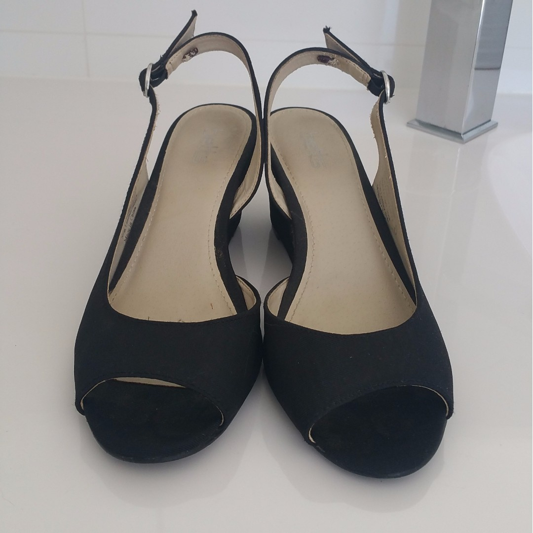 Betts black wedges