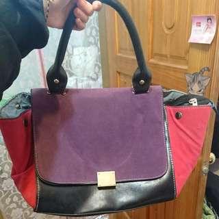 紫紅色手提包