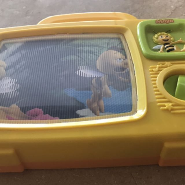 Yellow and green plastic Maya television toy for sale