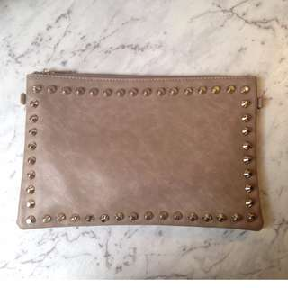 Gold studded over sized clutch