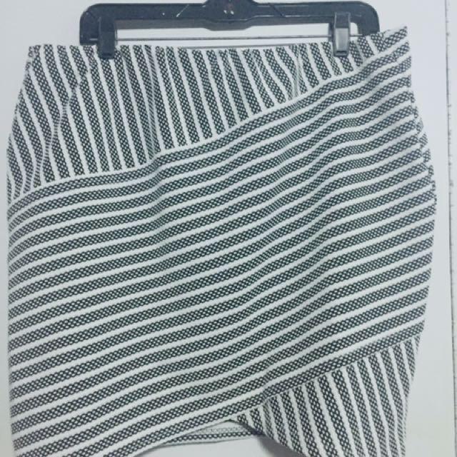 Apostrophe Asymmetrical Hem Mini Skirt