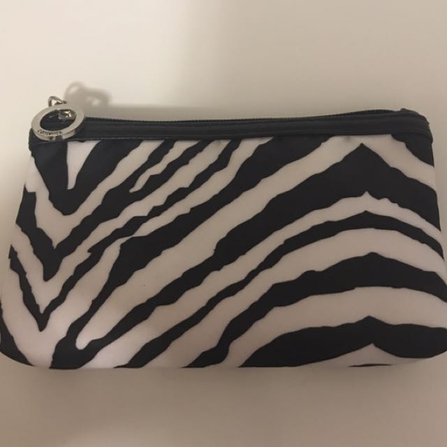 White and black zebra print pouch for sale