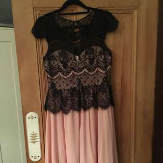 Review size 10 pink cocktail dress with black lace peplum, cap sleeve overlay covering sweetheart neckline