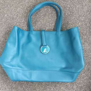 Agnes b 藍色皮袋