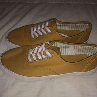 Vans-style mustard colored shoes