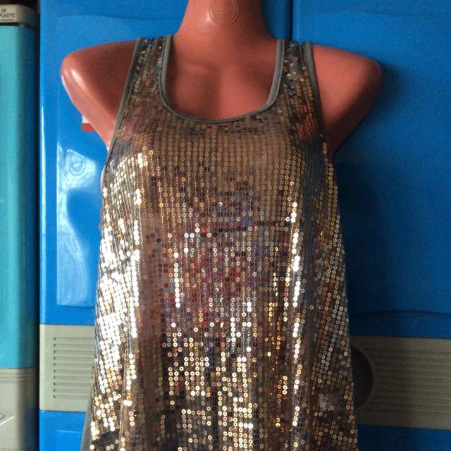 sleeveless glittered top