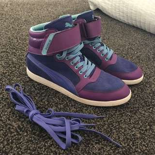 Puma Women's Purple High tops Size 7