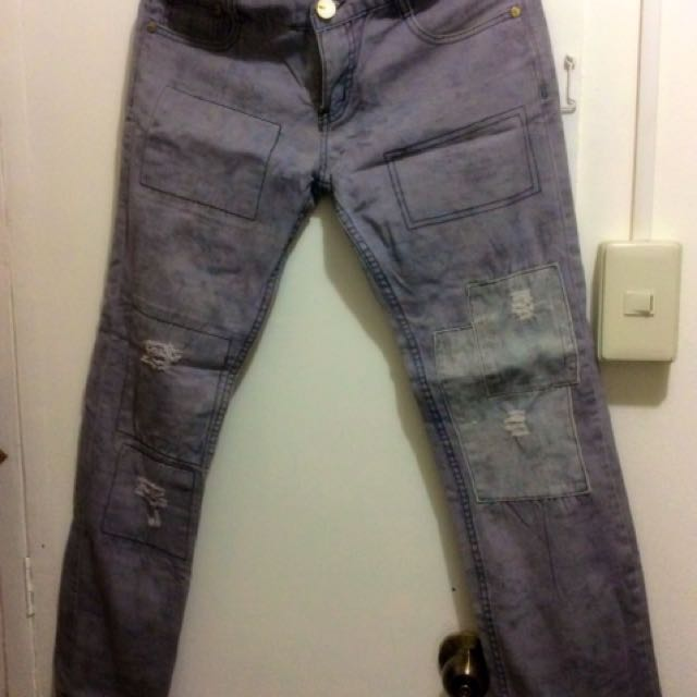 Folded and Hung Distressed Jeans