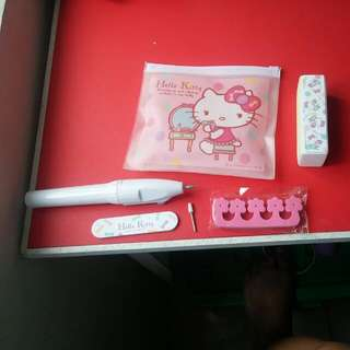 Hello kitty nai files and toe thingies and electronic nail cleaning