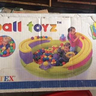 Inflatable plus lots of plastic balls