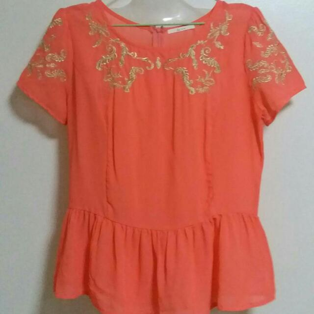 Orange peplum top with gold embroidery