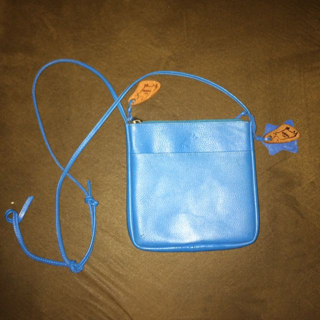 OUR TRIBE SLING BAG