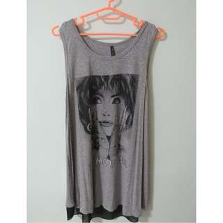 Loose fit grey top with sheer back