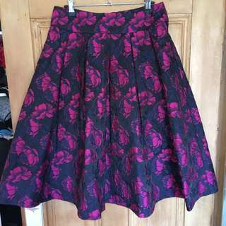 Review size 10 blue, magenta and black Aline Skirt with floral self print.