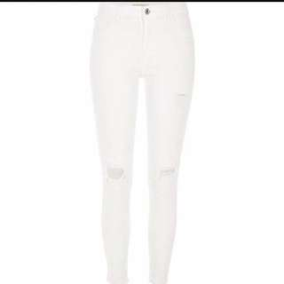Ripped White Skinny Jeans.