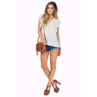 Tobi dolled up top in Ivory