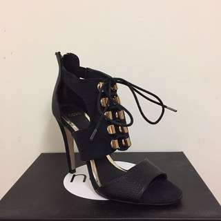 Black And Gold Zip And Lace Up Heels