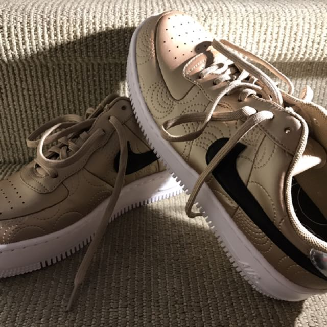 NIKE GOLD RUNNERS ### Size 8 Near New