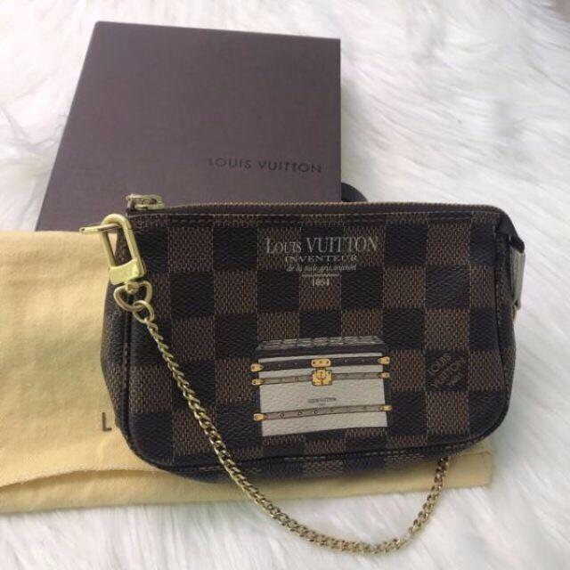 Authentic Louis Vuitton mini porchette trunks and locks limited