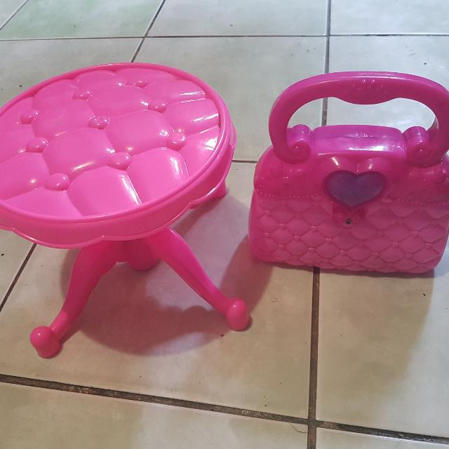 pink kiddie chair and plastik toy bag for kids