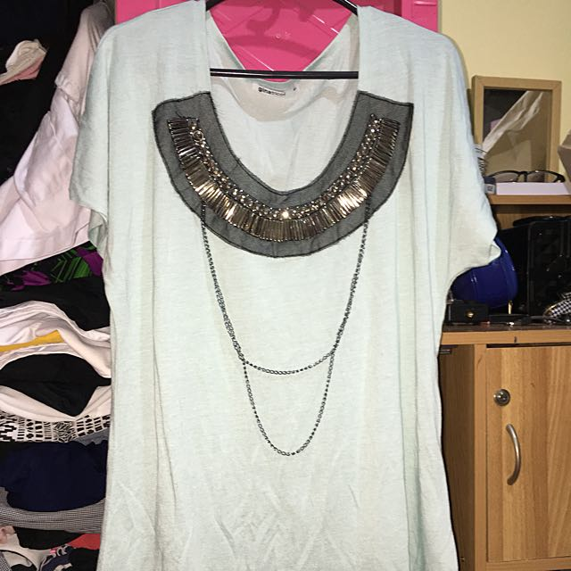 Blouse with attached necklace