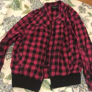 Pink and black checkered sweater