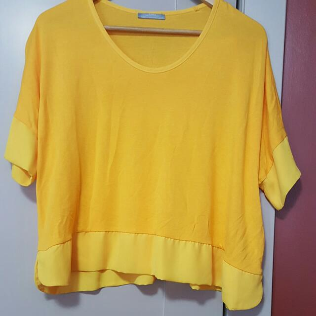 Loose yellow top