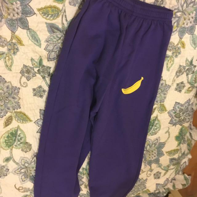 Purple and yellow wilson sweatpants