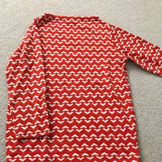 orange and white patterned sweater