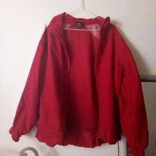 red puffy windbreaker jacket