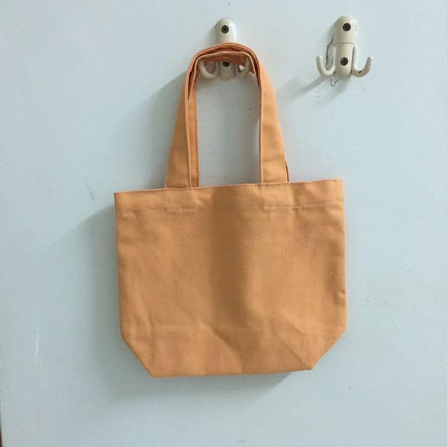 粉橘色小提袋