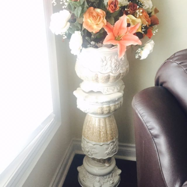 White Vase With A Stand