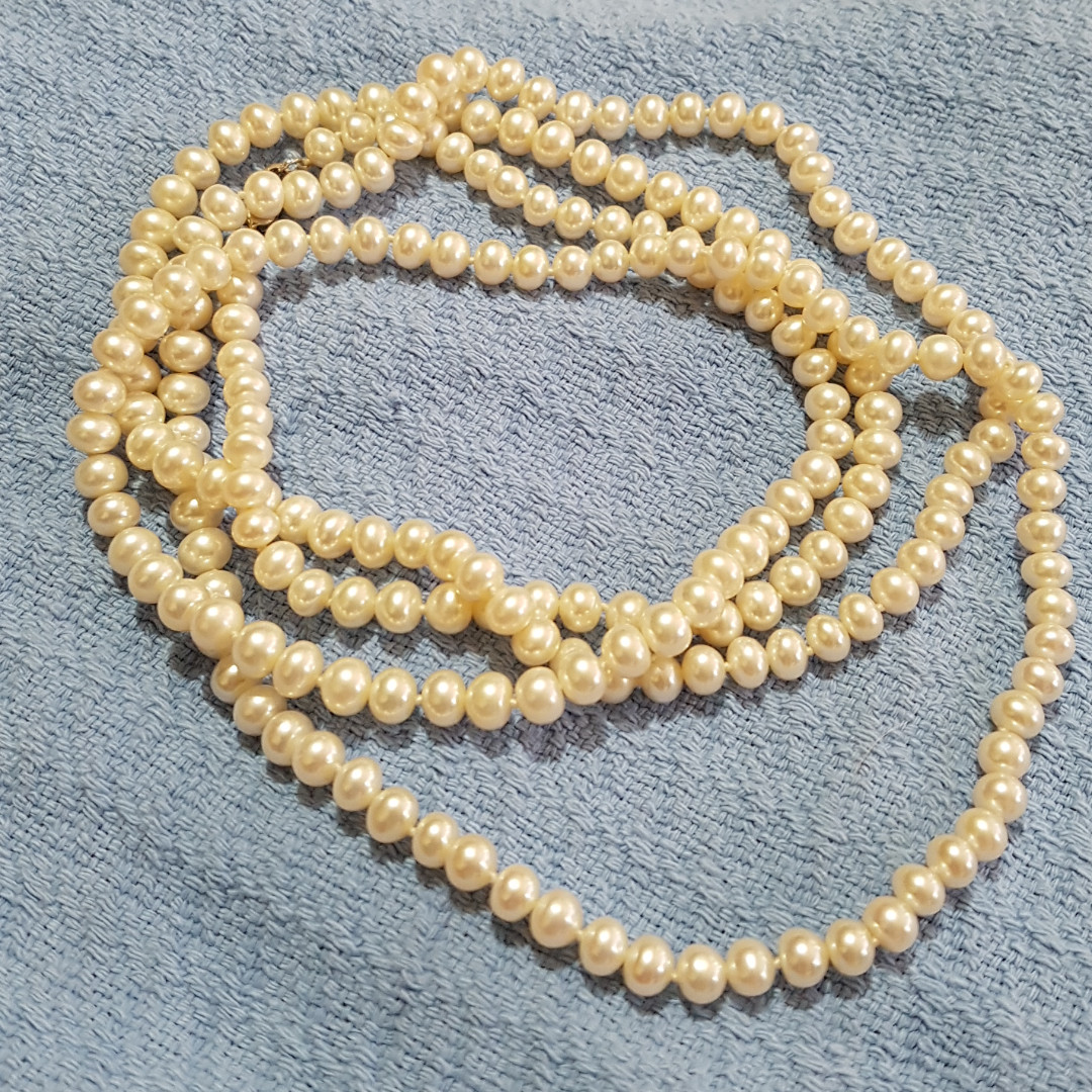 24 inches Long Fresh Water Cultured White Pearl Necklace