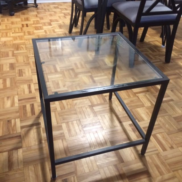 Two glass top tables set