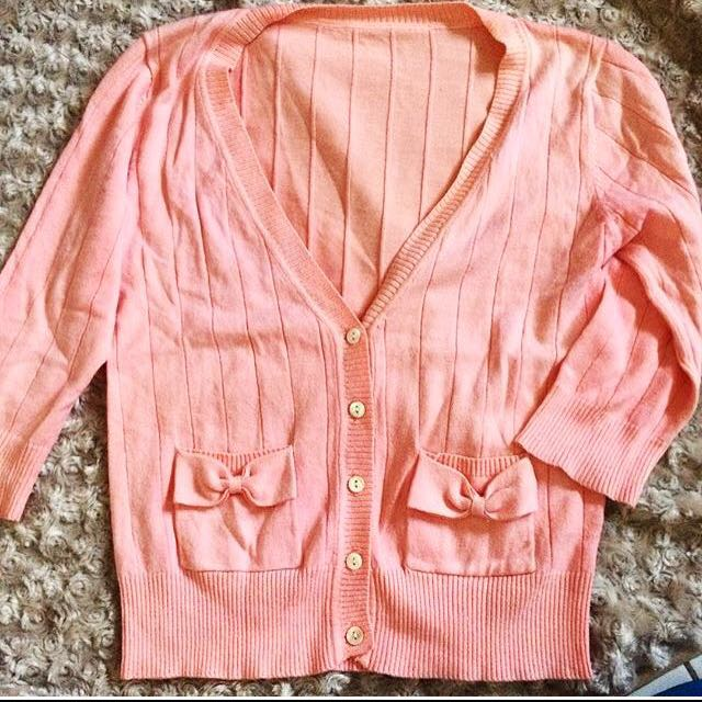 Pink cardigan with bow detail