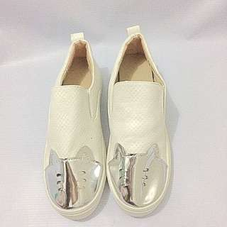 White Shoes With Metallic Design