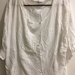 Oversized white t-shirt with butterfly detail
