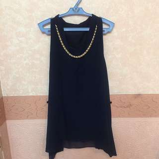sleeveless navy blue blouse with pearl chain