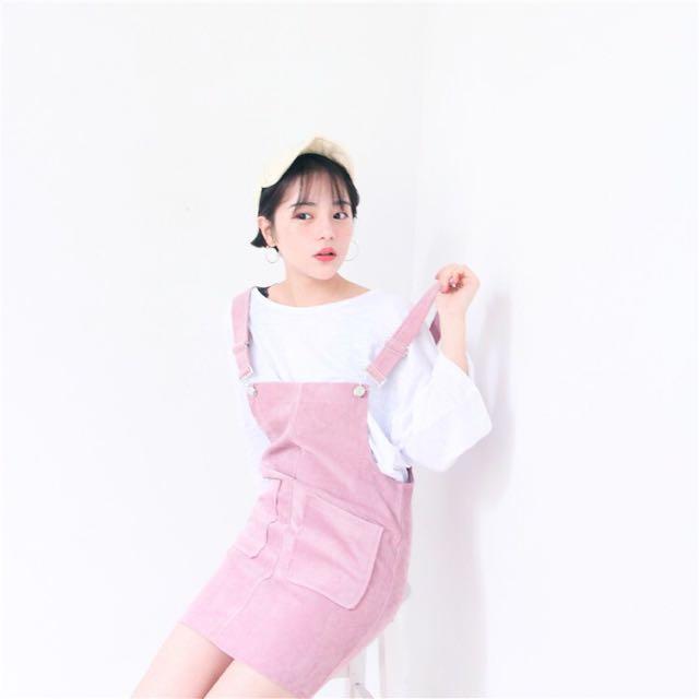 韓版燈芯絨雙口袋貼身包臀粉色吊帶裙