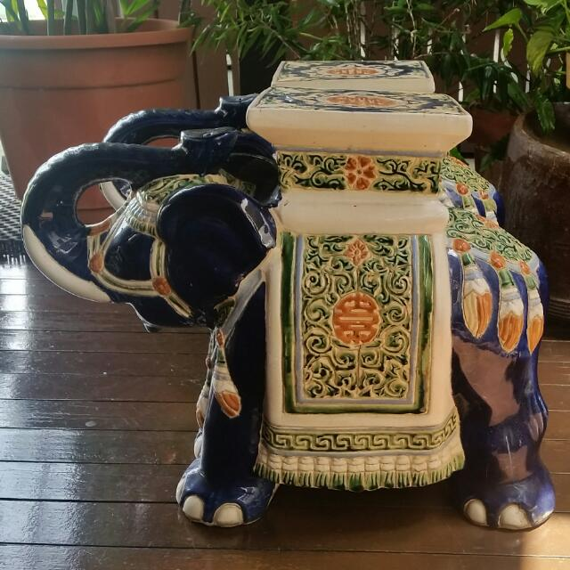 A pair of porcelain elephant stools for good fengshui