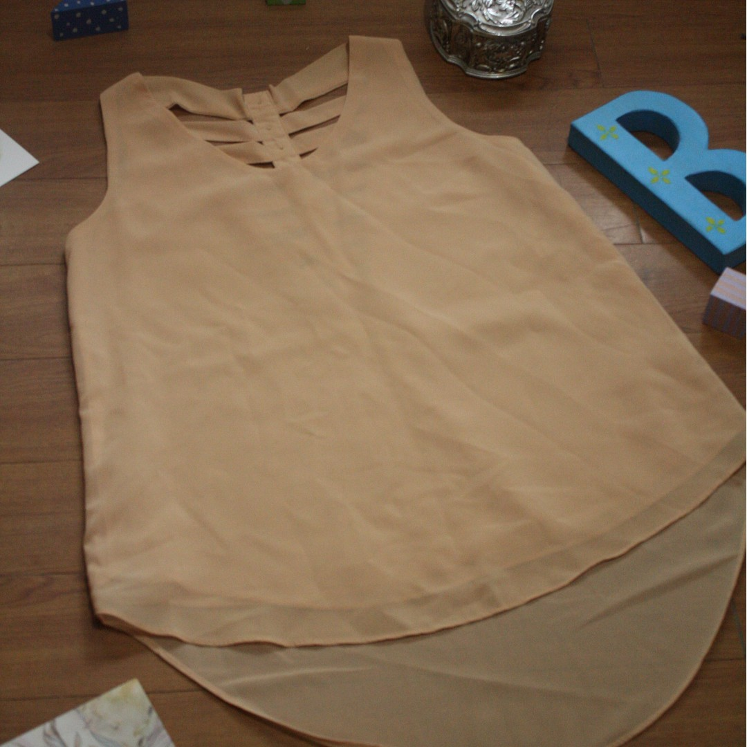 Beige Sleeveless Blouse
