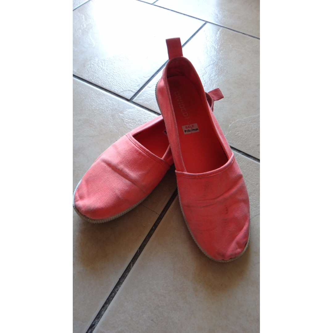 Divided Neon Pink Slip ons