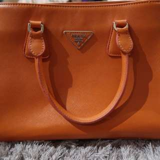 Orange Prada Handbag