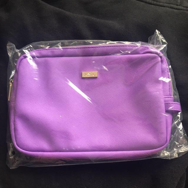 Purple TARTE Makeup Bag
