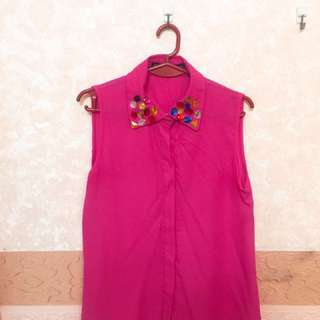 pink sleeveless top with bejeweled collar
